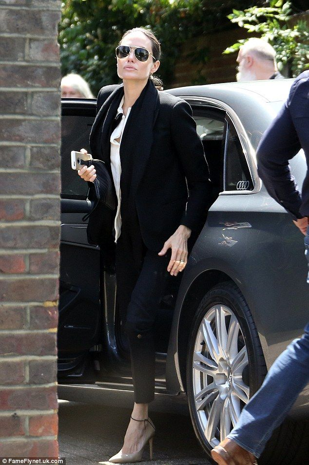 She's arrived: Angelina Jolie was seen arriving at London recording studios Air with her husband Brad Pitt on Saturday, only to be followed in by Coldplay's Chris Martin