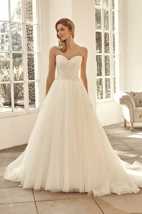 A ball-gown style dress with beaded bodice and tulle skirt.  <strong>Size…