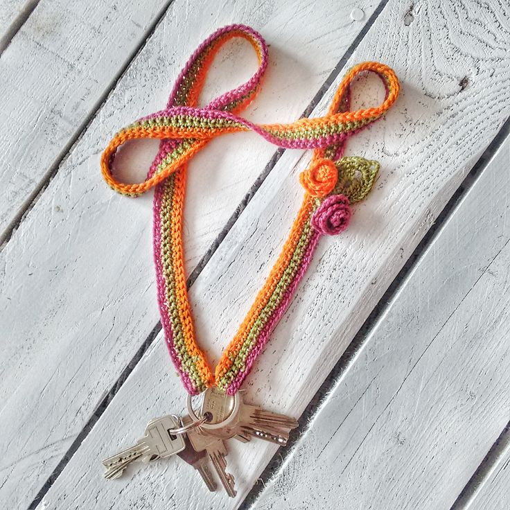 Make everyday objects pretty: crochet lanyard with flowers. Lanyard: dc all the way except the last row, which is slip stich. Attach trinkets (amigurumis, flowers, etc.) to your liking.