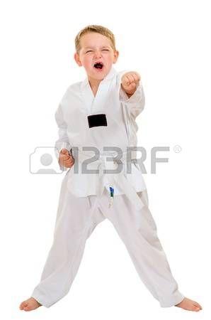 Child practicing his taekwondo moves isolated on white photo
