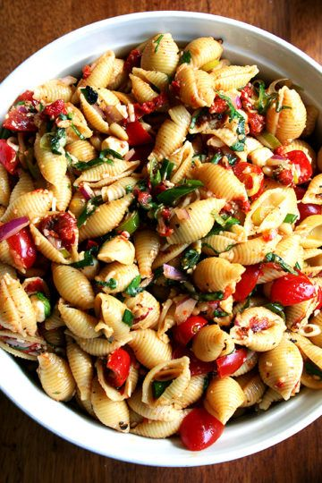 This simple pasta salad is particularly good warm, when the shells melt the cheese, slightly cook the tomatoes and soak up the olive oil and lemon juice.