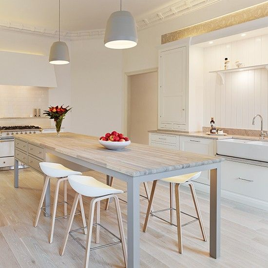 This gorgeous pale wooden extended cook's table perfectly complements the wooden floor in this open and light kitchen. Love the double butler style sink and dining chairs. overall a very clean and clutter free look. http://www.housetohome.co.uk/room-idea/picture/white-kitchen-design-ideas-10-of-the-best/11