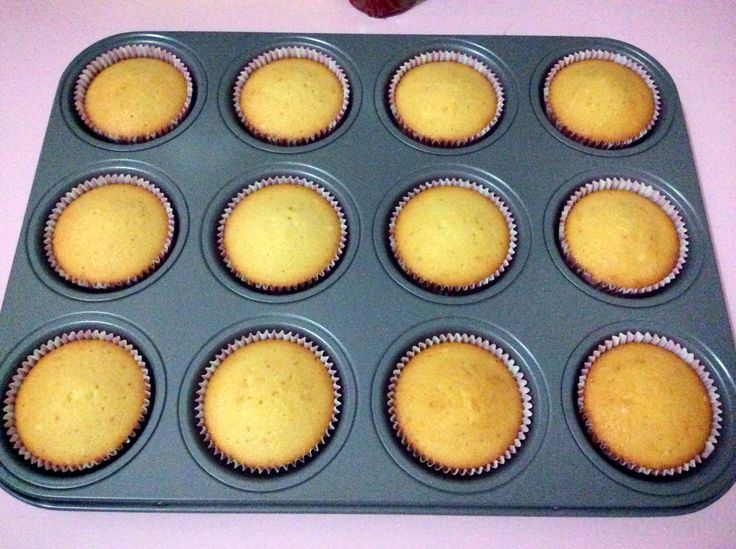 Vanilla cupcake magnolia, fresh from the oven. No topping yet.