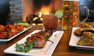 Diners nosh on upscale New American food, such as shrimp skewers, Black Angus burgers, and pepper-crusted pork chops