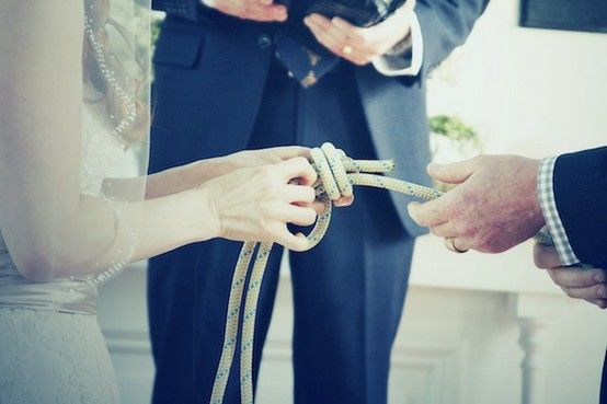 They actually tied a knot. They tied a fisherman's knot. It's the strongest knot. The rope will break before the knot comes undone and the knot only gets tighter with pressure. Frame the knot and vows as a keepsake. WAY better than the usual candle or sand elements. :)