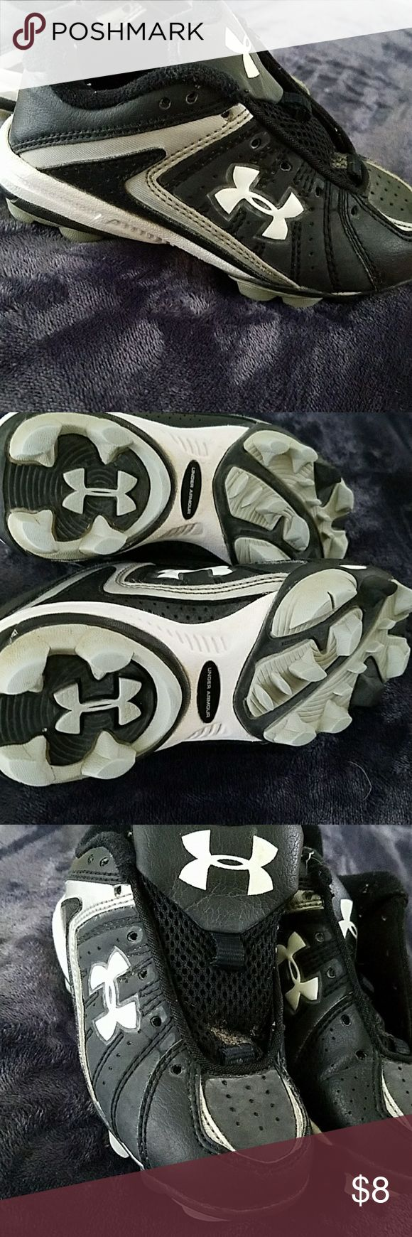 Under Armour Cleats Size 10 (Toddler Size) Gently used pair of Under Armour cleats WITHOUT laces with a little dirt in the lower portion of the tongues of both shoes (in spite of being cleaned). There is minimal signs of wear otherwise as they were only used two seasons at the most. I posted pictures of the minor noticeable wear. These would be great for a little tball player! Under Armour Shoes Sneakers