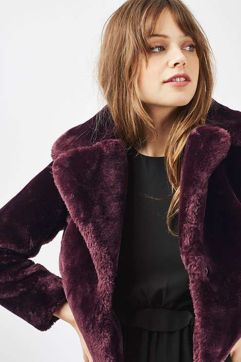 Both ways practical and on-trend, this faux fur chubby-style coat comes in a rich burgundy, finished with a cool cropped fit. A winter wardrobe staple, we've styled ours over a midi dress and ankle boots. #Topshop
