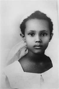 Iman as a serious young girl