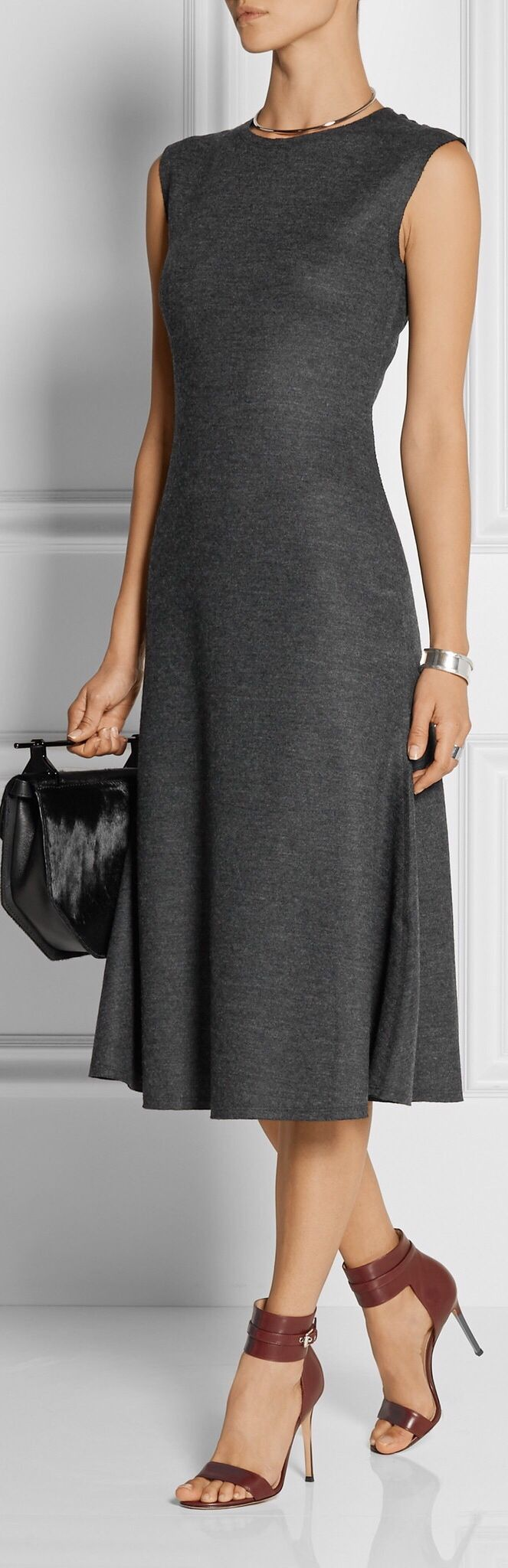 I like the style of this dress, although the neckline might be too high to look good on my broader shoulders. It's also a little long for me, but other than that....Dress | Streamlined | Sculptural | Ladylike |