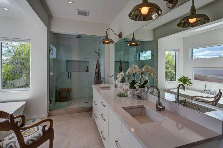 White bathroom with walk-in stand up shower and separate bathrub | Calgary