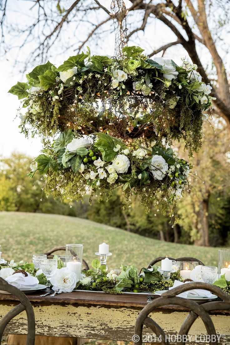 Grapevine Chandelier: This two-tiered DIY chandelier is made from grapevine wreaths, white  blooms, greenery,Lighting