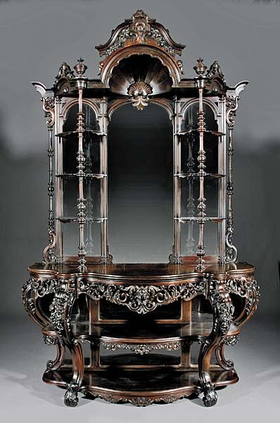 """American Rococo carved and laminated rosewood étagère. This mid-19th century beauty attributed to John and Joseph W. Meeks, NY and boasts a floral carved strapwork crest. Standing 104"""" tall, the étagère has a segmented arched mirror back flanked by six shelves on turned supports. A curvaceous serpentine top with a reticulated apron adds to the piece's overall appeal as do its cabriole legs and scroll feet."""