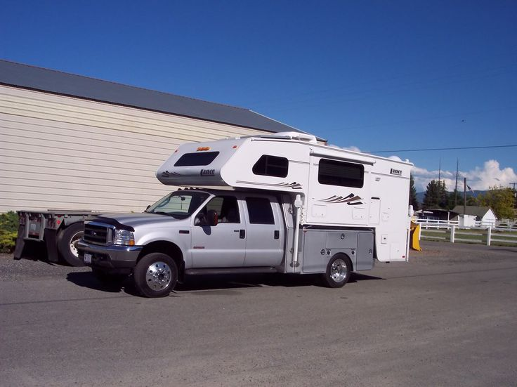 Long thread about putting truck campers on flatbeds, discussing issues to overcome, options, etc.  (This truck is actually a utility bed and not a flatbed, but it still has the additional storage in the boxes.)