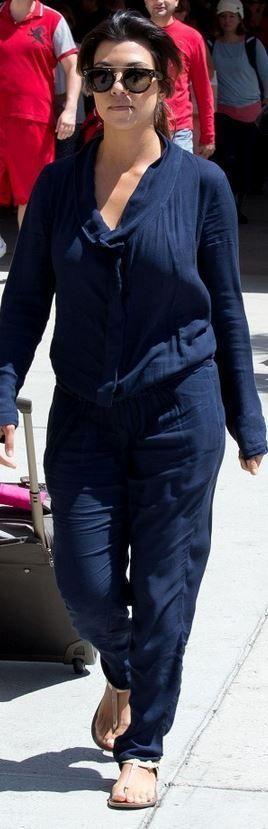 Kourtney Kardashian: Sunglasses – Celine  Jumpsuit – Young Broke & Fabulous  Shoes – Fendi
