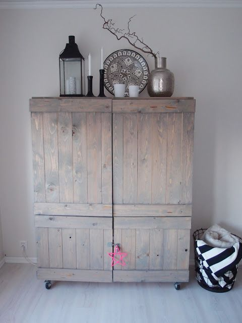 I like this barnboard / grey washed cubpoard. Could be used for a variety of storage or to hide electronics.