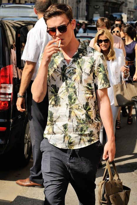 I don't know who he is, but I like the fact that he's wearing a shirt with palm trees on it.