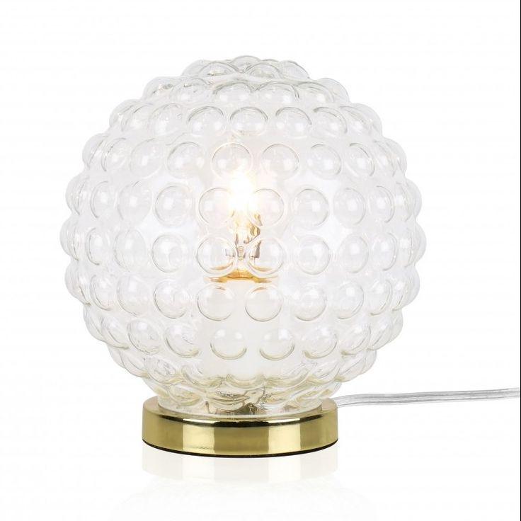 Bordlampna Spring är gjord i klart bubbligt 20-tals glas som ger en spännande ljusspridning. Fot i mässing och transparent sladd med brytare.  Lamphållare E27 Max 40W