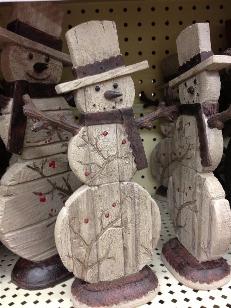 Wooden snowmen ~ I love these! > Love the  branches carved in them. Could also maybe just paint the branches & glue on red beads from a holiday sprig