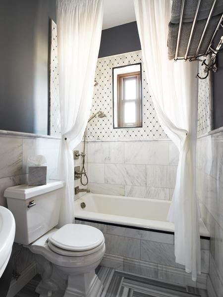 contemporary white bathroom with two extra long shower curtains hung close to the ceiling making the bathroom look HUGE!... Beautiful Bathroom Inspiration: Contemporary Shower Curtain Ideas from Bathroom Bliss by Rotator Rod