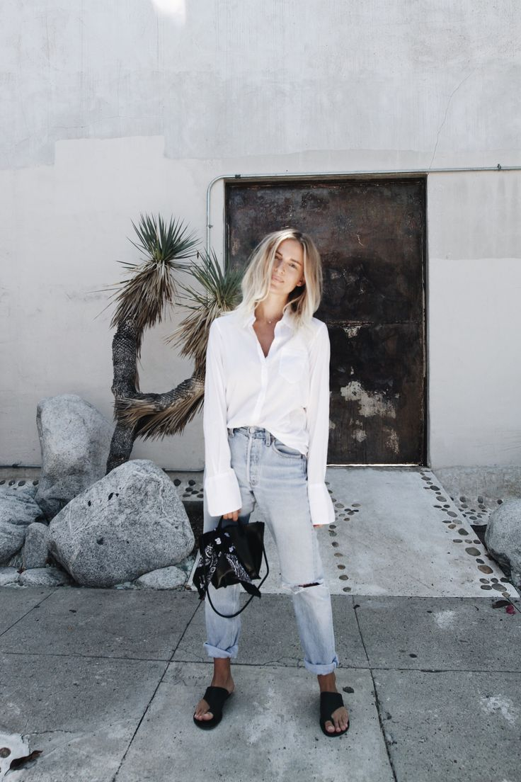 NILI LOTAN       white shirt  (similar here)  LEVIS     vintage 501 jeans (or here)  KOZHA NUMBERS      black leather bag  POPPY & CO     black bandana TONY BIANCO    leather sandals