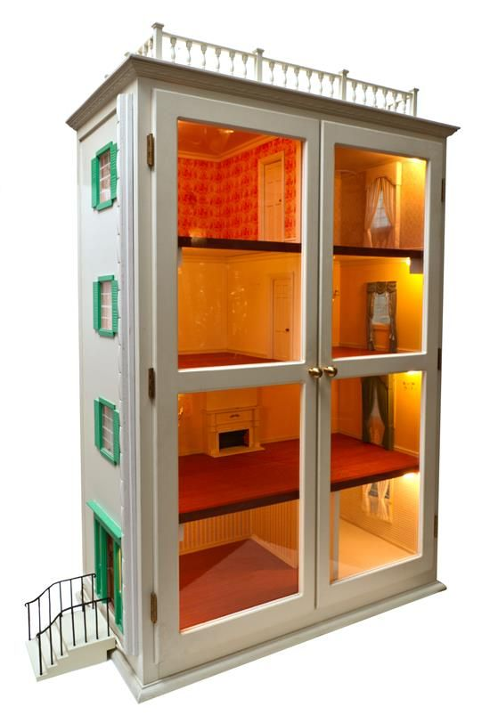 A Painted Dollhouse Cabinet, Height 49 x width 33 x depth 18 inches. (jt-could make nice block of apartments, each with its own character and design))