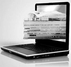 laptop newspaper