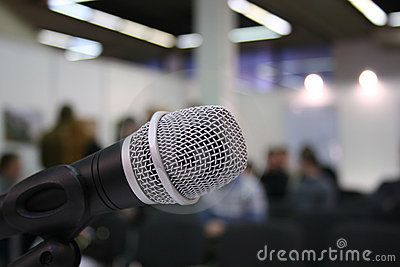 Stock Photo: Closeup microphone in auditorium with people