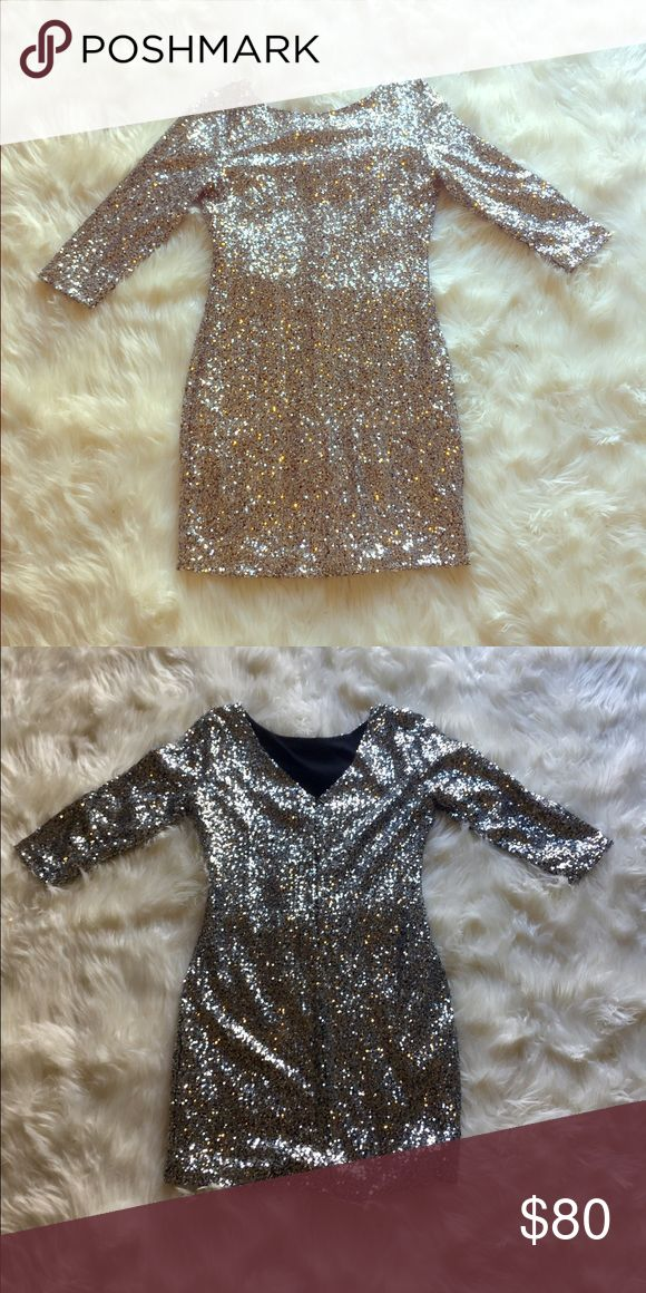 "Gianni Bini Silver Sequin Glam Mini Dress This eye catching Gianni Bini Mini Dress in size L is perfect for holiday parties or New Years! Black hidden back zipper detail and 3/4 sleeves with double lining inside make this perfect for all occasions. I am 5'6"" and this Dress falls just above mid thigh. Gorgeous with tights and boots or a matching pair of sling backs depending on the weather! Gianni Bini Dresses Mini"