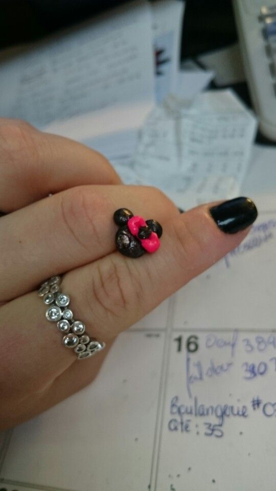 Minnie Mouse earring in polymer clay Still need some work on the bow :)