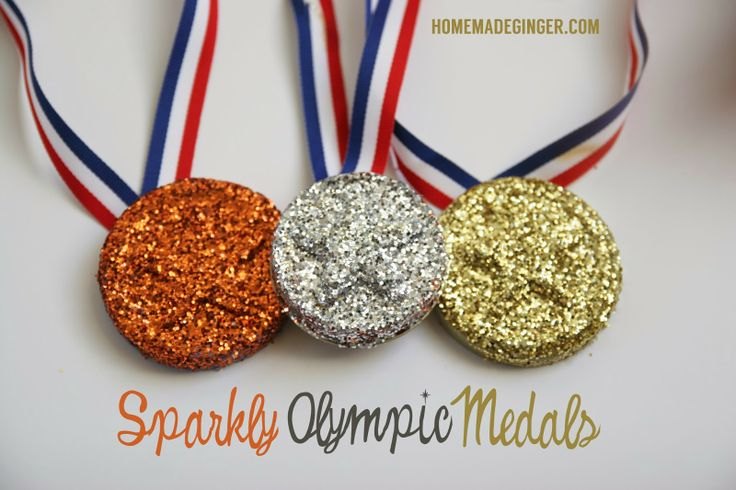 DIY Sparkly Olympic Medals using glitter and mason jar lids. Perfect Olympic craft for kids!