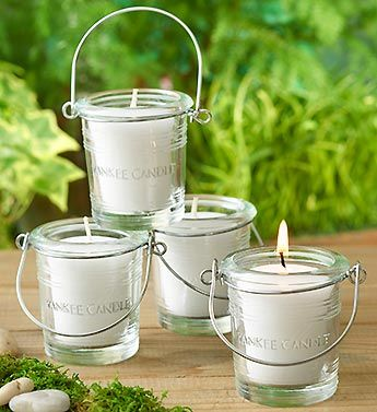 Yankee Candle Citronella Set- Set of four mosquito-blocking Conceal® votive candles from Yankee Candle® in lantern-style holders #candles #lanterns