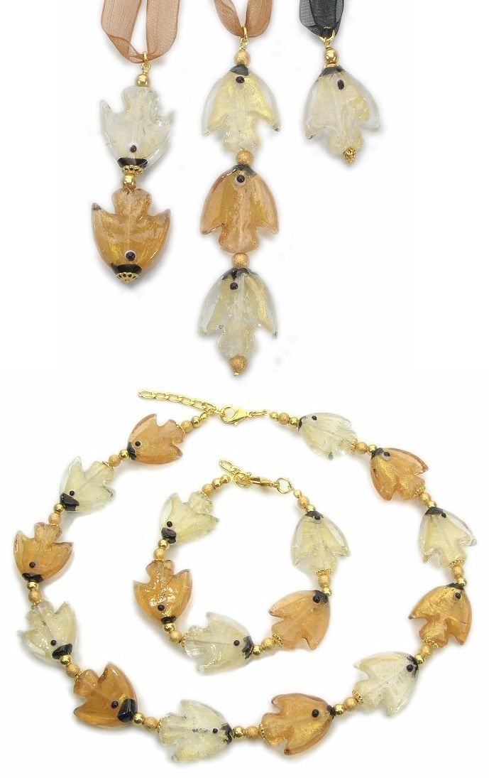 Exquisite fish shaped pendants with 24k gold foil, lenght from mm.60 to mm.90. Made in Italy. Below, custom made jewelry, necklace and bracelet made from fish glass beads (mm.25) with 24 gold foil. Forms of animals, especially marine, are often found in many costume jewelry made from Murano glass manufacture.