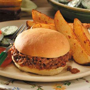 Family-Pleasing Sloppy Joes   2 pounds ground beef 1 large onion, chopped 1-1/4 cups ketchup 1/2 cup water 1 tablespoon brown sugar 1 tablespoon white vinegar 1/2 teaspoon salt 1/2 teaspoon ground mustard 1/2 teaspoon chili powder 1/4 teaspoon ground allspice 8 sandwich buns, split