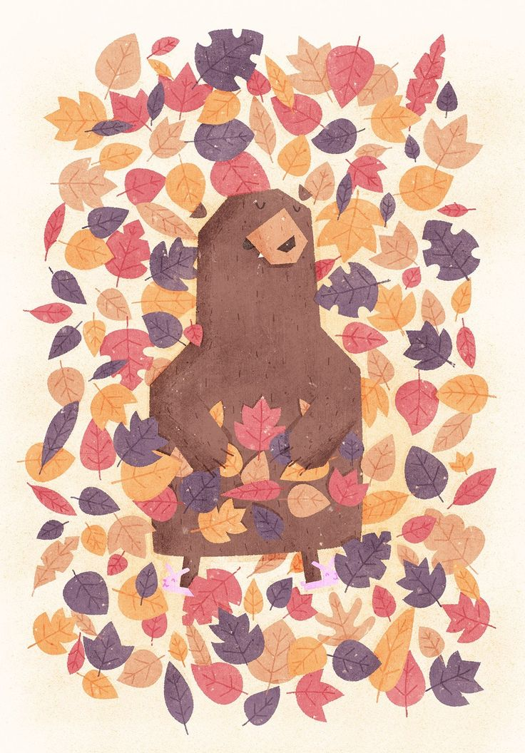An adorable bear hibernating trying to get some sleep in a pile of leaves.