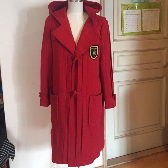 New Authentic Chanel coat hood and patch 40 red Gorgeous chanel coat. New without tags. 100%authentic. Super gorgeous pleated design and a luxuriois red color. Size 40. 100%wool, lining is 100%silk. CHANEL Jackets & Coats