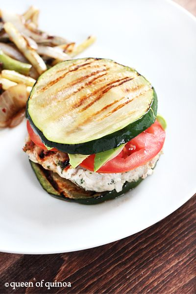 "Herbed Turkey Burgers with Zucchini Buns - YUM! I have tried doing the whole ""lettuce as a replacement bun"" thing, but it doesn't work for me. I don't like that it is cold, and I don't like that it has no ""meat"" to it. Grilled zuch is great! Sounds delicious."