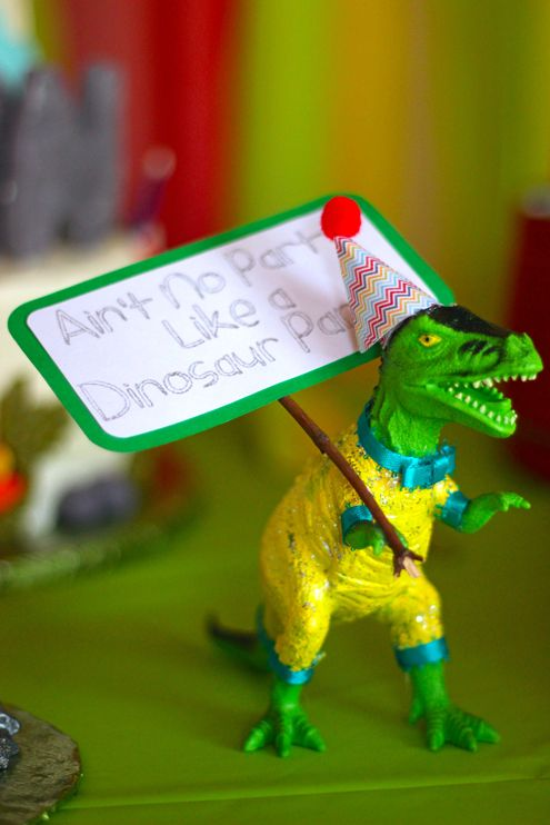 Party dinosaurs for a dino-mite first birthday party!  They came dressed in their party attire, including party hats and carrying fun signs. Via Where The Smiles Have Been. #firstbirthday #dinosaurs