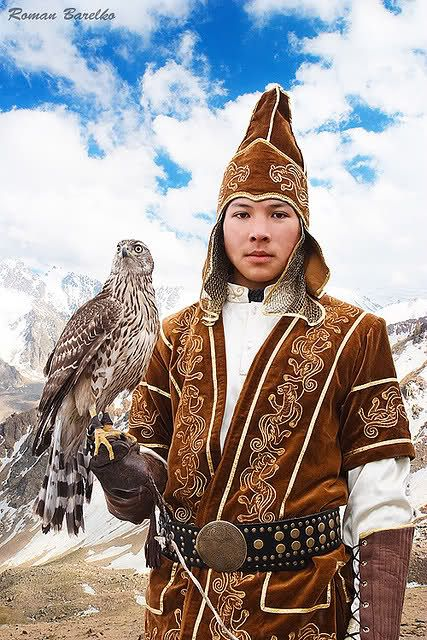 Nomadic Kazakh hunter with hunting eagle, Kazakhstan.