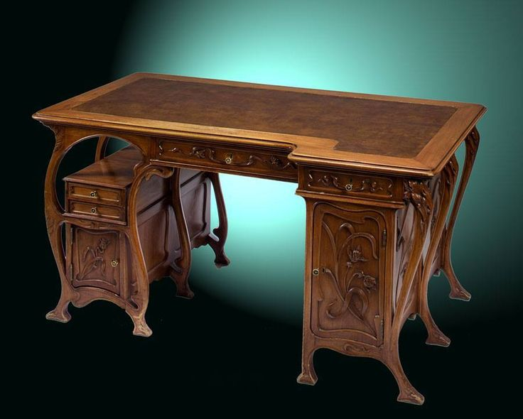 An Art Nouveau carved mahogany and leather topped desk, France circa 1900.