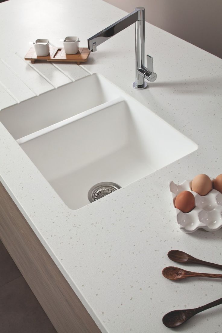 Bushboard has taken its encore solid surface worktop range up another notch with the launch of white moulded acrylic sinks and four new crystal designs