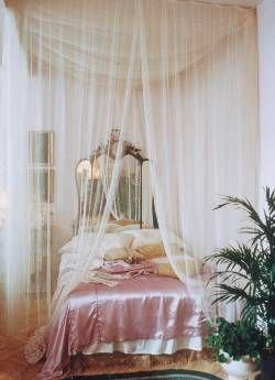 """""""Blush satin bedspread and mirrored headboard behind a gossamer curtain."""" .....Daaaaamn."""