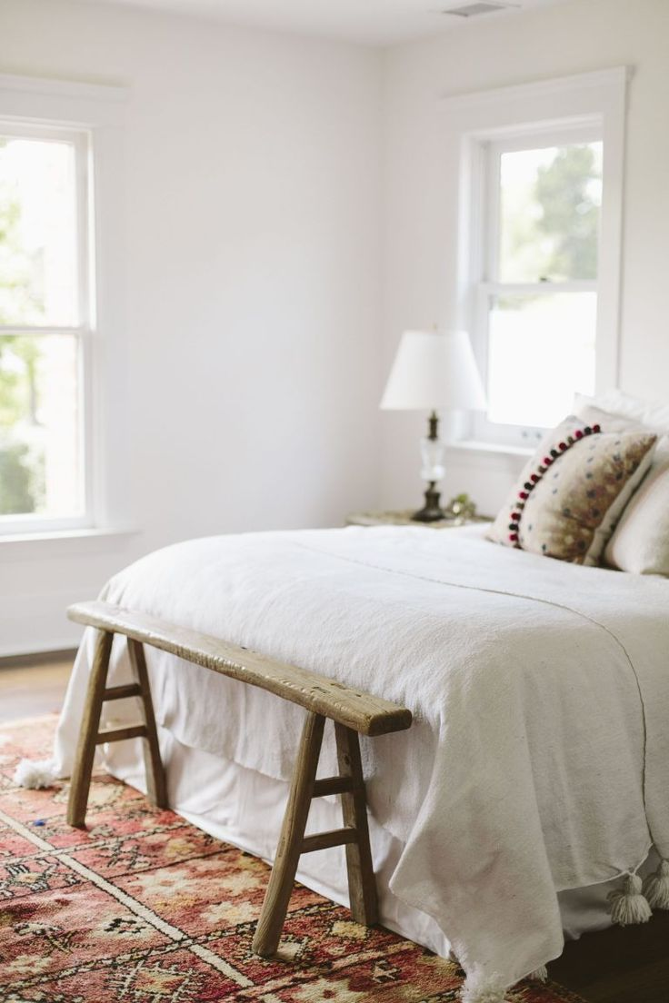 This simple wooden bench looks great at the end of this bed!