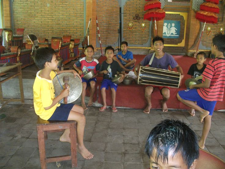 Practicing Baleganjur (Balinese traditional musical instrument)