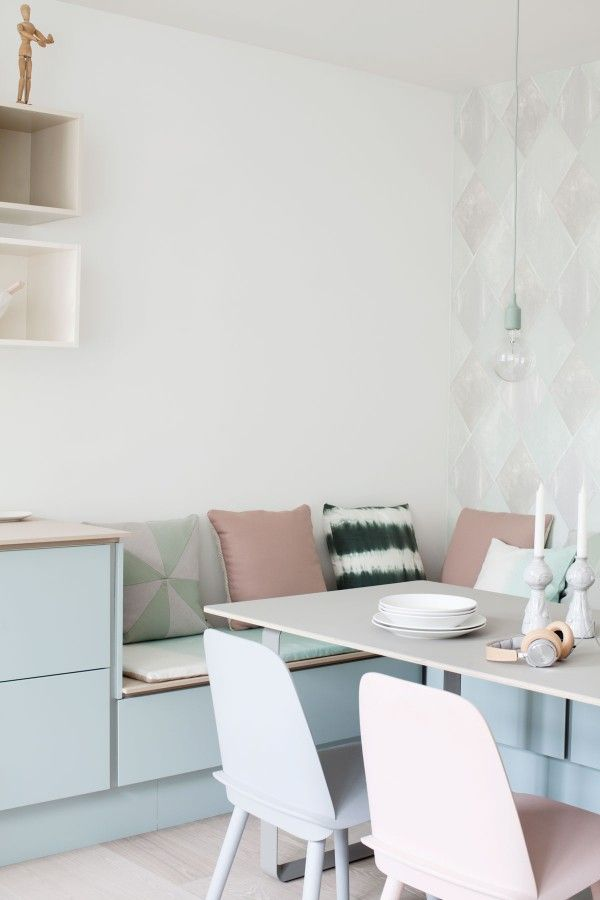 Ignore the colors, but the design of the benches in this dining nook are great. I wonder if we could use IKEA kitchen drawers?