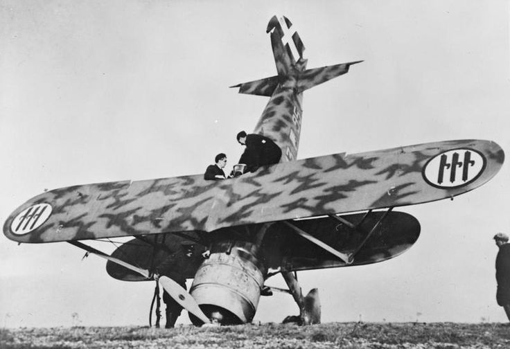THE BATTLE OF BRITAIN  An Italian Fiat CR 42 biplane fighter of 18° Gruppo, 56° Stormo, Corpo Aereo Italiano, which crash-landed at Orfordness in Suffolk during the Regia Aeronautica's only major daylight raid of the Battle of Britain, 11 November 1940. The Italian formation, comprising a dozen BR.20 bombers and their escorts making towards Harwich, was intercepted by Hurricanes of Nos. 17, 46 and 257 Squadrons.