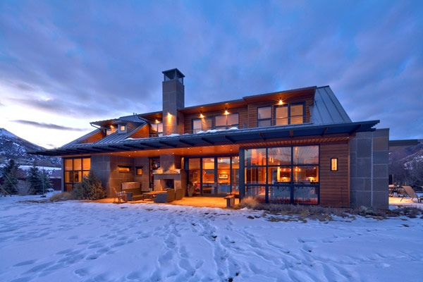 Architecture, Exterior South In Winter Snow House Home Fireplace Chimney Lighting Wooden Wall Glass Window Aspen Ski Hotels Resorts Colorado Vacation Contemporary Architecture Designs Stay Snowmass Snowboarding Mountain Chalet Packages: Charming, Picturesque Rural Villa Outside Aspen, Capturing Views of Ski Areas