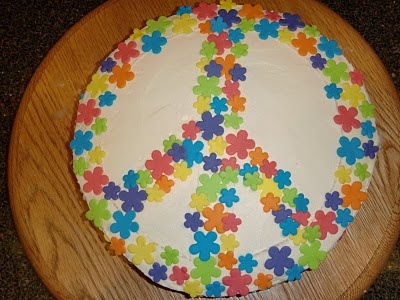 Peace Sign / Flower Power hippie cake... I think I would cut out the white