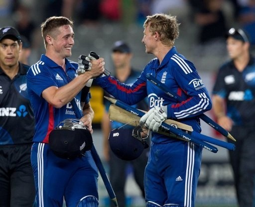 England's Chris Woakes and Joe Root celebrate victory in the third and final one-day international against New Zealand in Auckland