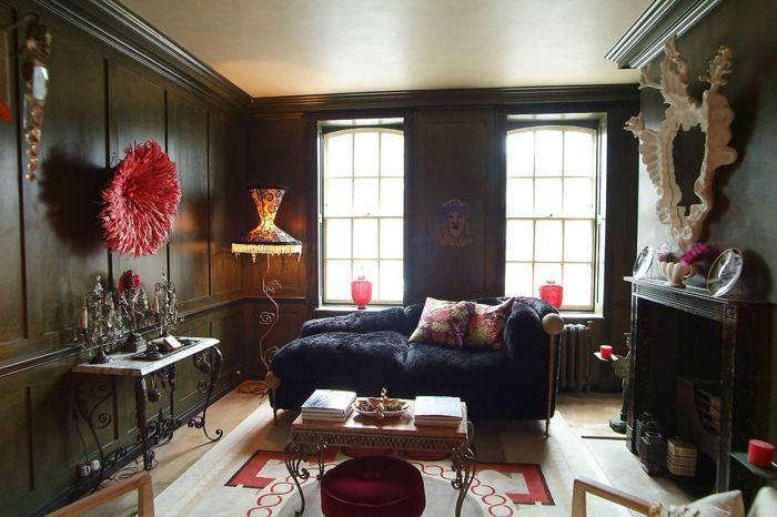 schwarze wandfarbe wohnzimmer farbiger teppich rote akzente