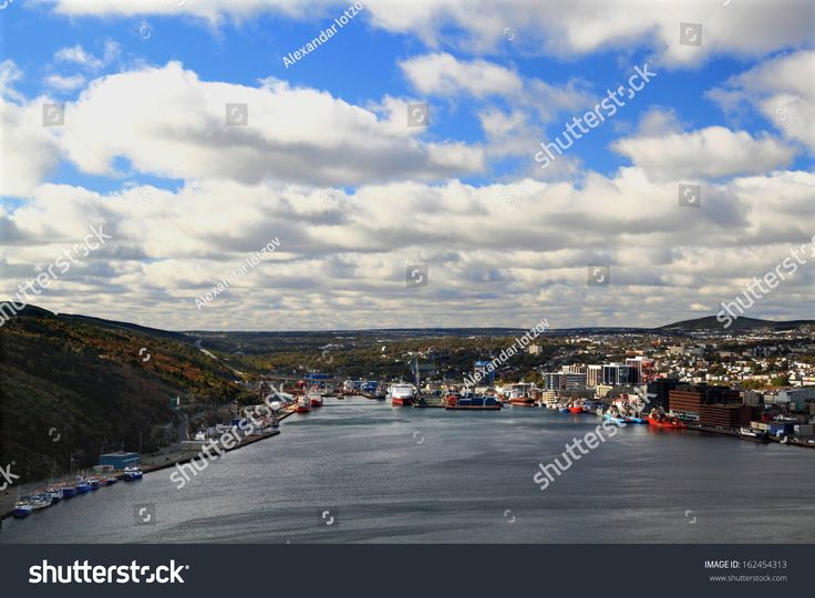 Panoramic view of St. John's Newfoundland, Canada harbor and town in cloudy day.